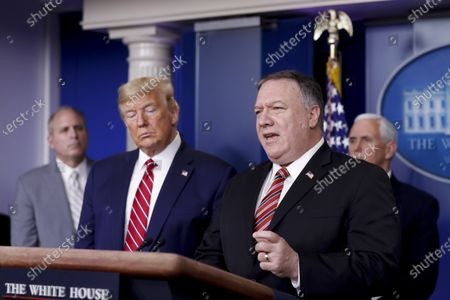 United States Secretary of State Mike Pompeo, speaks as US President Donald Trump, second left, listens during a Coronavirus Task Force news conference in the briefing room of the White House. Photographer: Al Drago/Bloomberg