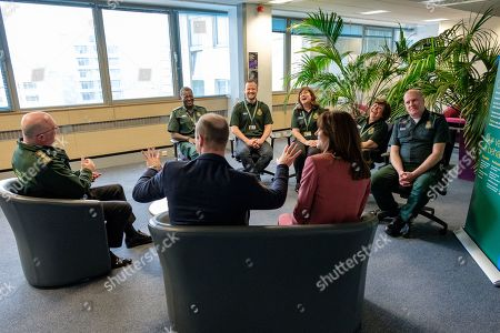 Stock Image of Prince William and Catherine Duchess of Cambridge talking with staff during a visit to the London Ambulance Service 111 control room in Croydon on Thursday to meet ambulance staff and 111 call handlers who have been taking NHS 111 calls from the public, and thank them for the vital work they are doing