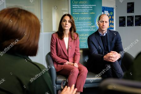 Stock Photo of Prince William and Catherine Duchess of Cambridge talking with staff during a visit to the London Ambulance Service 111 control room in Croydon on Thursday to meet ambulance staff and 111 call handlers who have been taking NHS 111 calls from the public, and thank them for the vital work they are doing
