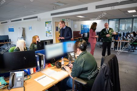 Prince William and Catherine Duchess of Cambridge talking with staff during a visit to the London Ambulance Service 111 control room in Croydon on Thursday to meet ambulance staff and 111 call handlers who have been taking NHS 111 calls from the public, and thank them for the vital work they are doing
