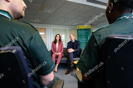 Stock Picture of Prince William and Catherine Duchess of Cambridge talking with staff during a visit to the London Ambulance Service 111 control room in Croydon on Thursday to meet ambulance staff and 111 call handlers who have been taking NHS 111 calls from the public, and thank them for the vital work they are doing