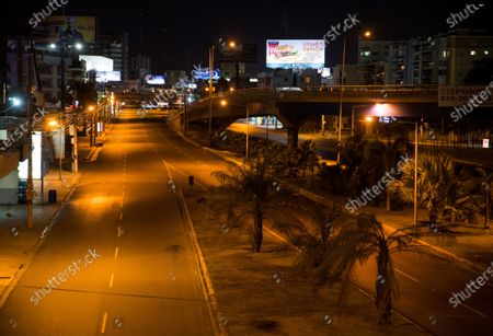 View of an empty road after a curfew began, in Santo Domingo, Dominican Republic, 20 March 2020. The Dominican President Danilo Medina ordered a curfew to be put in place in an attempt to combat coronavirus and COVID-19, prohibiting the transit and movement of people from 8:00pm to 6:00 am.