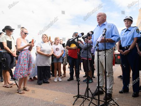 Stock Photo of Minister for Police and Emergency Services David Elliott (2-R) speaks during a press conference at Bondi Beach in Sydney, Australia, 21 March 2020. Beachgoers drew condemnation yesterday when tens of thousands of people flouted social distancing rules, which have been put in place in an effort to limit the spread of COVID-19.