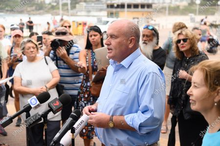 Stock Image of Minister for Police and Emergency Services David Elliott (C) speaks during a press conference at Bondi Beach in Sydney, Australia, 21 March 2020. Beachgoers drew condemnation yesterday when tens of thousands of people flouted social distancing rules, which have been put in place in an effort to limit the spread of COVID-19.