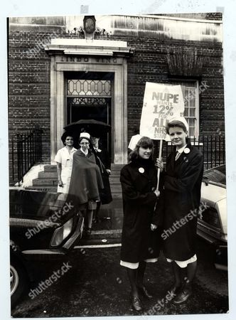 Strikes National Health Service 1982 Nupe Strike And Picket At St Mary's Hospital Nurses On Picket Duty At Various Entrances Of The Hospital Including 'the Lindo Wing' Where Princess Of Wales Left Yesterday. Pupil Nurses Heather Bright (left) & Louise Butterfield (right) Holding Placard. Pictured In The Foreground With Other Nurses Behind Including Ward Sister Gill Black.