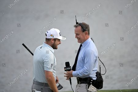Stock Photo of Sports and Golf Channel anchor Steve Sands, right, talks with Tyrrell Hatton, of England, after Hatton won the the Arnold Palmer Invitational golf tournament, in Orlando, Fla