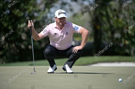 Graeme McDowell, of Northern Ireland, lines up a putt on the first green during the final round of the Arnold Palmer Invitational golf tournament, in Orlando, Fla