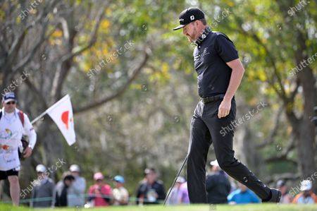 Jimmy Walker walks on the 10th green during the final round of the Arnold Palmer Invitational golf tournament, in Orlando, Fla