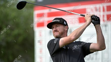 Jimmy Walker watches his tee shot on the 11th hole during the final round of the Arnold Palmer Invitational golf tournament, in Orlando, Fla