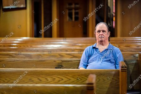 John Williams waits for worship services to begin in a near empty Central Presbyterian Church in Mobile, Alabama, USA, 22 March 2020. Many churches in Alabama have closed to web only services or limited the number who can attend in person help prevent the spread of the Coronavirus Covid-19 outbreak. Countries around the world are taking increased measures to stem the widespread of the SARS-CoV-2 coronavirus which causes the Covid-19 disease.
