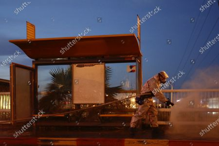 Stock Photo of A firefighter sprays disinfectant as a precaution against the coronavirus at the Moshe Dayan Railway Station in Rishon LeTsiyon, Israel
