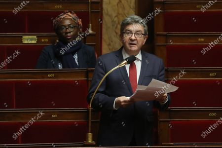 French lieftist party La France Insoumise's (LFI) deputy Jean-Luc Melenchon (R) speaks as fellow LFI deputy Daniele Obono (L) listens during a debate on an emergency law to face the spread of the COVID-19 infection caused by the novel coronavirus at the French National Assembly in Paris, France, 22 March 2020. France is under lockdown in an attempt to stop the widespread of the SARS-CoV-2 coronavirus causing the Covid-19 disease.