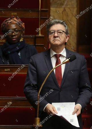"""French lieftist party La France Insoumise's (LFI) deputy Jean-Luc Melenchon speaks as fellow LFI deputy Daniele Obono listens at the French National Assembly in Paris . France's Parliament has adopted a bill allowing the government to declare a """"state of health emergency"""" meant to better fight the coronavirus epidemic in the country. For some people the COVID-19 coronavirus causes mild or moderate symptoms, but for some it can cause severe illness including pneumonia"""