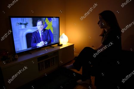 A girl watching Sweden's Prime Minister Stefan Lofven addressing the nation on coronavirus crisis broadcast on Swedish national public television, Stockholm, Sweden, 22 March 2020. Countries around the world are taking increased measures to stem the widespread of the SARS-CoV-2 coronavirus which causes the Covid-19 disease.