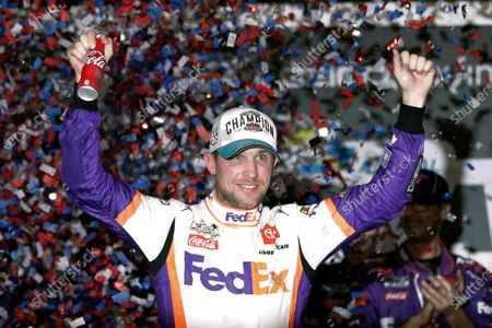 Denny Hamlin celebrates in Victory Lane after winning the NASCAR Daytona 500 auto race at Daytona International Speedway in Daytona Beach, Fla. NASCAR eased off the brake in the real sports world brought to a sudden halt by the coronavirus and introduced the country to iRacing with some of the sports biggest stars. Hamlin, the three-time Daytona 500 winner, beat Dale Earnhardt Jr. off the final corner Sunday, March 22, 2020 at virtual Homestead-Miami Speedway to win the bizarre spectacle