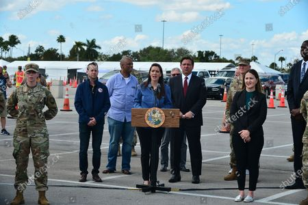 Lt. Governor Jeanette Nunez, (C), speaks during a news conference alongside Mayor of Miami Gardens Oliver G. Gilbert III (2nd from L), and Florida Gov. Ron DeSantis (2nd from R), Jared Moskowitz, Director of Florida's Division of Emergency Management (L), and President & Chief Executive Officer, Jackson Health System Carlos A. Migoya (2nd from L) at Hard Rock Stadium in Miami Gardens, Florida. DeSantis spoke at the stadium where the National Guard opened a coronavirus drive-thru testing site. On Sunday, they were only testing first responders. On Monday, they planned to expand it to people at least 65 years old who are showing symptoms of the illness.
