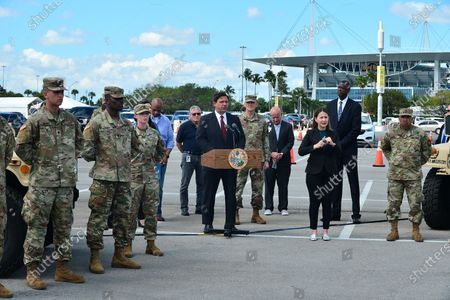 Florida Gov. Ron DeSantis (C), speaks during a news conference alongside Mayor of Miami Gardens Oliver G. Gilbert III (2nd from C), Lt. Governor Jeanette Nunez, (3rd from C), Jared Moskowitz, Director of Florida's Division of Emergency Management(4th from C), and President & Chief Executive Officer, Jackson Health System Carlos A. Migoya (2nd from R) at Hard Rock Stadium in Miami Gardens, Florida. DeSantis spoke at the stadium where the National Guard opened a coronavirus drive-thru testing site. On Sunday, they were only testing first responders. On Monday, they planned to expand it to people at least 65 years old who are showing symptoms of the illness.