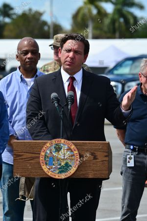 Florida Governor Ron DeSantis (R), speaks during a news conference alongside Mayor of Miami Gardens Oliver G. Gilbert III (L) at Hard Rock Stadium in Miami Gardens, Florida. DeSantis spoke at the stadium where the National Guard opened a coronavirus drive-thru testing site. On Sunday, they were only testing first responders. On Monday, they planned to expand it to people at least 65 years old who are showing symptoms of the illness.