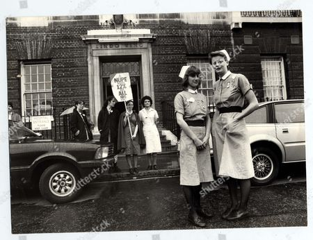 Stock Image of Strikes National Health Service 1982 Nupe Strike And Picket At St Mary's Hospital Nurses On Picket Duty At Various Entrances Of The Hospital Including 'the Lindo Wing' Where Princess Of Wales Left Yesterday. Pupil Nurses Heather Bright (left) & Louise Butterfield (right) Holding Placard. Pictured In The Foreground With Other Nurses Behind Including Ward Sister Gill Black.
