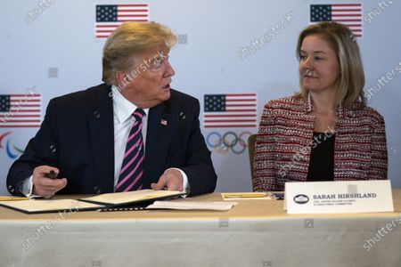 President Donald Trump speaks with CEO of the United States Olympic and Paralympic Committee Sarah Hirshland during a briefing with the U.S. Olympic and Paralympic Committee and Los Angeles 2028 organizers in Beverly Hills, Calif. Hirshland, the CEO of the U.S. Olympic team is well aware of the power her country wields in a situation like this, with the coronavirus raging across the globe and the IOC taking its time before deciding whether to postpone the Tokyo Games