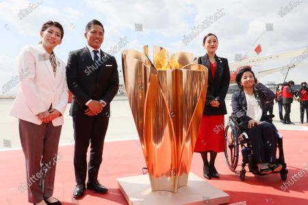 (L-R) Olympic gold medalists Saori Yoshida of wrestling, Tadahiro Nomura of judo, actress Satomi Ishihara and Paralympian Aki Taguchi smile as they attend the arrival ceremony for the Olympic flame at the Matsushima air base in Higashi Matsushima in Miyagi prefecture, northern Japan on Friday, March 20, 2020. Tokyo 2020 Olympic Games will start from March 26 at Fukushima prefecture.