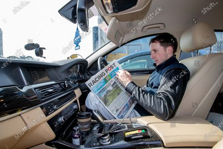 Jockey Conor Maxwell relaxes between races in his car as jockeys endeavour to maintain social distancing at the racecourse