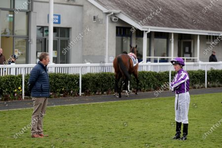 Travelling head lad Pat Keating and jockey Seamus Heffernan endeavour to maintain social distancing in the parade ring at Naas racecourse