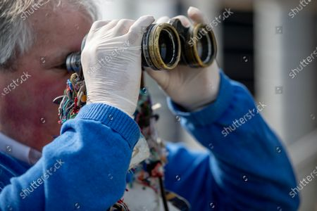 Stock Photo of A racing industry member wears gloves at Naas racecourse