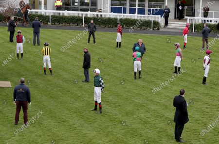 Jockeys and trainers endeavour to maintain social distancing in the parade ring at Naas racecourse