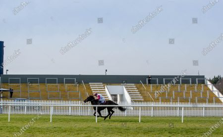 The Naas Nursery Of Champions Maiden. Ben Coen on Woodford General wins the race run in front of an empty stand at Naas
