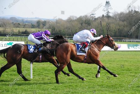 NAAS. POETIC FLARE and Kevin Manning beat off LIPIZZANER (Seamie Heffernan) to win for trainer Jim Bolger.