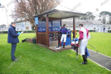 NAAS. WOODFORD GENERAL winning jockey Ben Coen (right) waiting to weigh in watched by IHRB Steward Paul Murtagh.