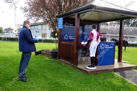 NAAS. WOODFORD GENERAL winning jockey Ben Coen weighs in watched by IHRB Steward Paul Murtagh.