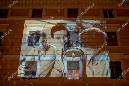 Scenes from the 1952 movie 'Le ragazze di Piazza di Spagna (Three girls from Rome) with Lucia Bose, center, is projected on a building in Rome, . The #cinemadacasa (movie from home) is an initiative of the Rome Film Fest's section Alice in the Cities to help people stay home during the coronavirus outbreak in Italy. Lucia Bose' died of pneumonia in Segovia, Spain, on Monday