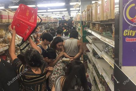 People line up to buy food and other supplies at a 24-hour supermarket in Yangon, Myanmar, following the first cases of coronavirus announcement. Myanmar has announced its first two confirmed cases of COVID-19, one in the nation's biggest city, Yangon, and the other in the western state of Chin. For most people, the new coronavirus causes only mild or moderate symptoms. For some it can cause more severe illness