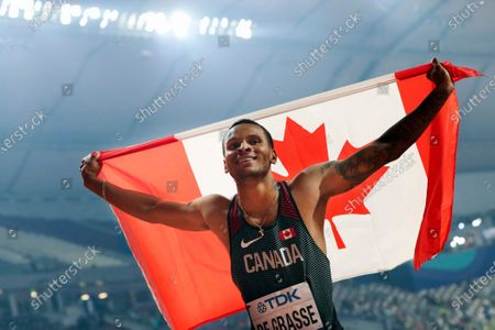 Canada's Andre De Grasse celebrates after winning the silver medal in the men's 200-meters at the World Athletics Championships in Doha, Qatar. Stunned at first, sprinter Andre De Grasse said he understands Team Canada's decision to not send a team to the Tokyo Olympics due to the coronavirus pandemic unless they were delayed a year