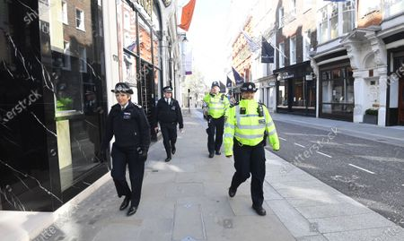 British police commissioner Cressida Dick (L) patrols Old Bond street in London, Britain, 24 March 2020. British Prime Minister Johnson has announced that Britons can only leave their homes for essential reasons or may be fined, in order to reduce the spread of the SARS-CoV-2 coronavirus which causes the Covid-19 disease, reports state.