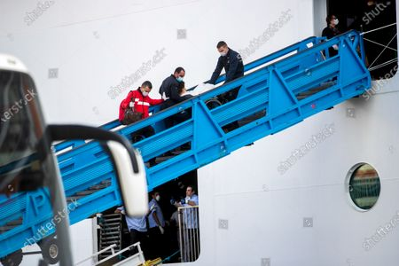 Passengers exit the Cruise Ship 'MSC Fantasia', that travelled from Brazil to Portugal with 1338 passengers on board, of 38 nationalitiesto, so that they can be taken by bus to the airport and later return to their home countries, at the Lisbon Harbour, Portugal, 24 March 2020. The passengers on board the cruise ship MSC Fantasia, in the Port of Lisbon, will begin to be repatriated, with four flights scheduled for Tuesday to Germany, Brazil and the United Kingdom.