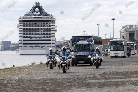 Buses transport passengers from the Cruise Ship 'MSC Fantasia', that travelled from Brazil to Portugal with 1338 passengers on board, of 38 nationalities, so that they can be taken by bus to the airport and later return to their home countries,  at the Lisbon Harbour, Portugal, 24 March 2020.