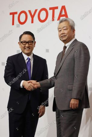 Stock Picture of Japan's automobile giant Toyota Motor president Akio Toyoda (L) shakes hands with Japan's telecommunication giant NTT Group president Jun Sawada (R) as they announce the companies will form a business and capital alliance in Tokyo on Tuesday, March 24, 2020. They also announced to develop a smart city at the foot of Mt. Fuji, former site of Toyota's Higashi Fuji plant.