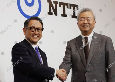 Stock Image of Japan's automobile giant Toyota Motor president Akio Toyoda (L) shakes hands with Japan's telecommunication giant NTT Group president Jun Sawada (R) as they announce the companies will form a business and capital alliance in Tokyo on Tuesday, March 24, 2020. They also announced to develop a smart city at the foot of Mt. Fuji, former site of Toyota's Higashi Fuji plant.