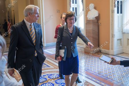 Republican Senator from Ohio Robert Portman (L) and Republican Senator from Maine Susan Collins (R) outside the US Senate Chamber at Capitol Hill in Washington, DC, USA, 24 March 2020. The Trump administration and Congress are continuing negotiations on a coronavirus COVID-19 stimulus package.