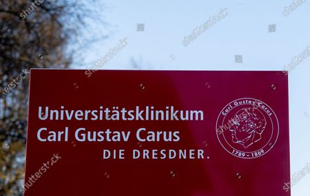 A sign at the main entrance of the University Hospital Carl Gustav Carus, in Dresden, Germany, 24 March 2020. According to Germany's Saxony state Prime Minister Michael Kretschmer, two Saxony Free State hospital will recieve Covid-19 patients from Italy who are unable to receive treatment in their own country.