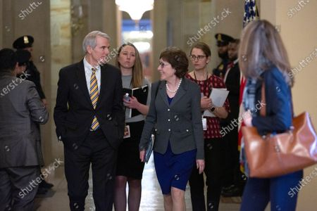 United States Senator Robert Portman (Republican of Ohio) and United States Senator Susan Collins (Republican of Maine) speak to members of the media at the United States Capitol.