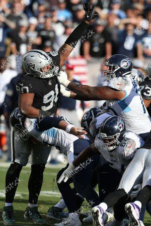 Raiders defensive tackle Johnathan Hankins (90) battles in the trenches with Rodger Saffold (76) during the Tennessee Titans 42-21 win against Oakland in a NFL football game in Oakland, CA