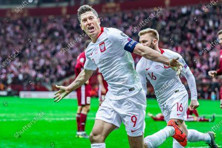 Robert Lewandowski of Poland celebrates a goal with Jakub Blaszczykowski of Poland