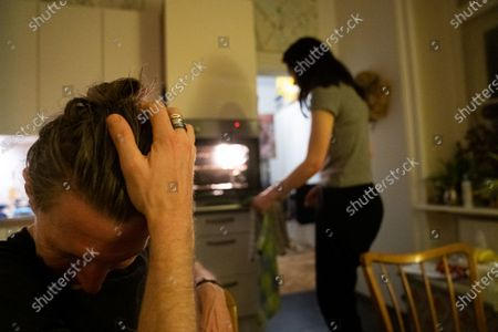 Thomas Smith (L), husband of Susanne Hassler-Smith, reacts during dinner in their shared flat in Vienna, Austria, 20 March 2020 (issued 25 March 2020). Susanne Hassler-Smith, 30-year-old Austrian freelance photographer and videographer from Graz, Styria, married Thomas Smith, 34-year-old American video editor and stock trader, on 20 February 2020 in Graz, Austria. Soon after, they had to cancel their honeymoon in Venice, Italy, as the spread of the Covid-19 disease had broken out in Europe. While in the midst of moving Susanne's home from Graz to Vienna in February, they finished settling in a shared flat in Vienna a week before Covid-19 matters worsened. Susanne will apply for a Green Card, Thomas' scheduled flight back to Los Angeles was cancelled, as were many other international flights worldwide due to the global coronavirus outbreak. Susanne and Thomas begun applying for VISA extensions for his stay in the European Union to overcome the crises together. Now, they are a part of a shared flat in Vienna, together with roommates from France and Germany, whom the couple didn't know before. 'With everything as it is at the moment, we don't plan too far ahead and take each day as it comes,' Susanne says. 'We stick to the home office lifestyle and social distancing measures as instructed to help flatten the curve of this epidemic.' They keep the daily routine as normal for everyone as possible. Coffee, work, lunch, workout, dinner and from time to time they meet for a coffee in the kitchen or on the balcony on sunny days. Austrian Chancellor Kurz had announced extended restrictions concerning the movement of individuals, the closure of commercial activities and other extensions of the preventive measures aimed at slowing down the pandemic COVID-19 disease caused by the SARS-CoV-2 coronavirus, from 16 March 2020 on until at least Easter Monday, 13 April 2020.