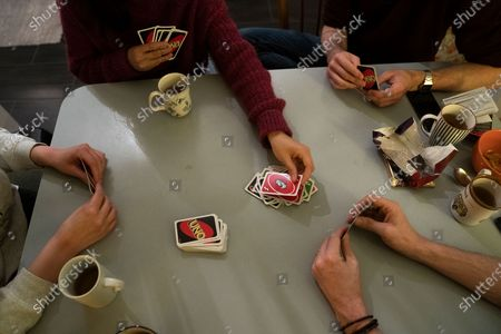 Thomas Smith (R), husband of Susanne Hassler-Smith, and roommates are playing cards in their shared flat in Vienna, Austria, 21 March 2020 (issued 25 March 2020). Susanne Hassler-Smith, 30-year-old Austrian freelance photographer and videographer from Graz, Styria, married Thomas Smith, 34-year-old American video editor and stock trader, on 20 February 2020 in Graz, Austria. Soon after, they had to cancel their honeymoon in Venice, Italy, as the spread of the Covid-19 disease had broken out in Europe. While in the midst of moving Susanne's home from Graz to Vienna in February, they finished settling in a shared flat in Vienna a week before Covid-19 matters worsened. Susanne will apply for a Green Card, Thomas' scheduled flight back to Los Angeles was cancelled, as were many other international flights worldwide due to the global coronavirus outbreak. Susanne and Thomas begun applying for VISA extensions for his stay in the European Union to overcome the crises together. Now, they are a part of a shared flat in Vienna, together with roommates from France and Germany, whom the couple didn't know before. 'With everything as it is at the moment, we don't plan too far ahead and take each day as it comes,' Susanne says. 'We stick to the home office lifestyle and social distancing measures as instructed to help flatten the curve of this epidemic.' They keep the daily routine as normal for everyone as possible. Coffee, work, lunch, workout, dinner and from time to time they meet for a coffee in the kitchen or on the balcony on sunny days. Austrian Chancellor Kurz had announced extended restrictions concerning the movement of individuals, the closure of commercial activities and other extensions of the preventive measures aimed at slowing down the pandemic COVID-19 disease caused by the SARS-CoV-2 coronavirus, from 16 March 2020 on until at least Easter Monday, 13 April 2020.
