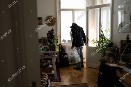 Thomas Smith, husband of Susanne Hassler-Smith, leaves for some shopping in their shared flat in Vienna, Austria, 21 March 2020 (issued 25 March 2020). Susanne Hassler-Smith, 30-year-old Austrian freelance photographer and videographer from Graz, Styria, married Thomas Smith, 34-year-old American video editor and stock trader, on 20 February 2020 in Graz, Austria. Soon after, they had to cancel their honeymoon in Venice, Italy, as the spread of the Covid-19 disease had broken out in Europe. While in the midst of moving Susanne's home from Graz to Vienna in February, they finished settling in a shared flat in Vienna a week before Covid-19 matters worsened. Susanne will apply for a Green Card, Thomas' scheduled flight back to Los Angeles was cancelled, as were many other international flights worldwide due to the global coronavirus outbreak. Susanne and Thomas begun applying for VISA extensions for his stay in the European Union to overcome the crises together. Now, they are a part of a shared flat in Vienna, together with roommates from France and Germany, whom the couple didn't know before. 'With everything as it is at the moment, we don't plan too far ahead and take each day as it comes,' Susanne says. 'We stick to the home office lifestyle and social distancing measures as instructed to help flatten the curve of this epidemic.' They keep the daily routine as normal for everyone as possible. Coffee, work, lunch, workout, dinner and from time to time they meet for a coffee in the kitchen or on the balcony on sunny days. Austrian Chancellor Kurz had announced extended restrictions concerning the movement of individuals, the closure of commercial activities and other extensions of the preventive measures aimed at slowing down the pandemic COVID-19 disease caused by the SARS-CoV-2 coronavirus, from 16 March 2020 on until at least Easter Monday, 13 April 2020.