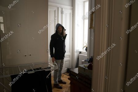 Thomas Smith, husband of Susanne Hassler-Smith, leaves for some shopping in their shared flat in Vienna, Austria, 21 March 2020 (issued 25 March 2020). Susanne Hassler-Smith, 30-year-old Austrian freelance photographer and videographer from Graz, Styria, married Thomas Smith, 34-year-old American video editor and stock trader, on 20 February 2020 in Graz, Austria. Soon after, they had to cancel their honeymoon in Venice, Italy, as the spread of the Covid-19 disease had broken out in Europe. All while in the midst of moving Susanne's home from Graz to Vienna in the month of February, they finished settling in amongst a shared flat in Vienna a week before Covid-19 matters worsened. They had chosen Vienna, which is 'a better place for work and travel than Graz.' Susanne mentions, as a new home base for their plan to commute between Austria and the US before Susanne will apply for an American green card. Thomas' scheduled flight back to Los Angeles was soon canceled, as were many other international flights worldwide due to the global outbreak of the Coronavirus. As a result, Susanne and Thomas have begun applying for VISA extensions for his stay in the European Union to challenge the crises together. Now, they are a part of a shared flat in Austrian capital Vienna, together with roommates from France and Germany, whom the couple didn't know before. Susanne states, 'With everything as it is at the moment, we don't plan too far ahead and take each day as it comes.' In the beginning all roommates followed the news several times a day, but as of day three with the extended restrictions concerning the movement of individuals, they started to relax a bit, accept the new situation and stopped running for every push notification on their phones. Susanne continues, 'We stick to the home office lifestyle and social distancing measures as instructed to help flatten the curve of this epidemic. Since I had planned a lot of video editing work before the lock down announcement, it is
